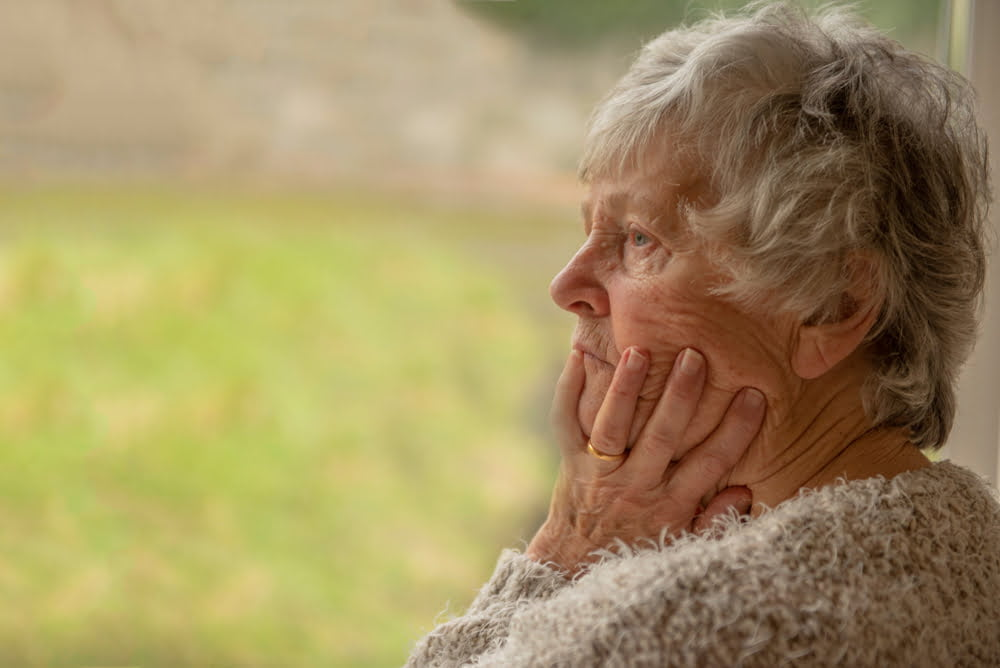 older woman with hands wrapped around her face, prelude home difference