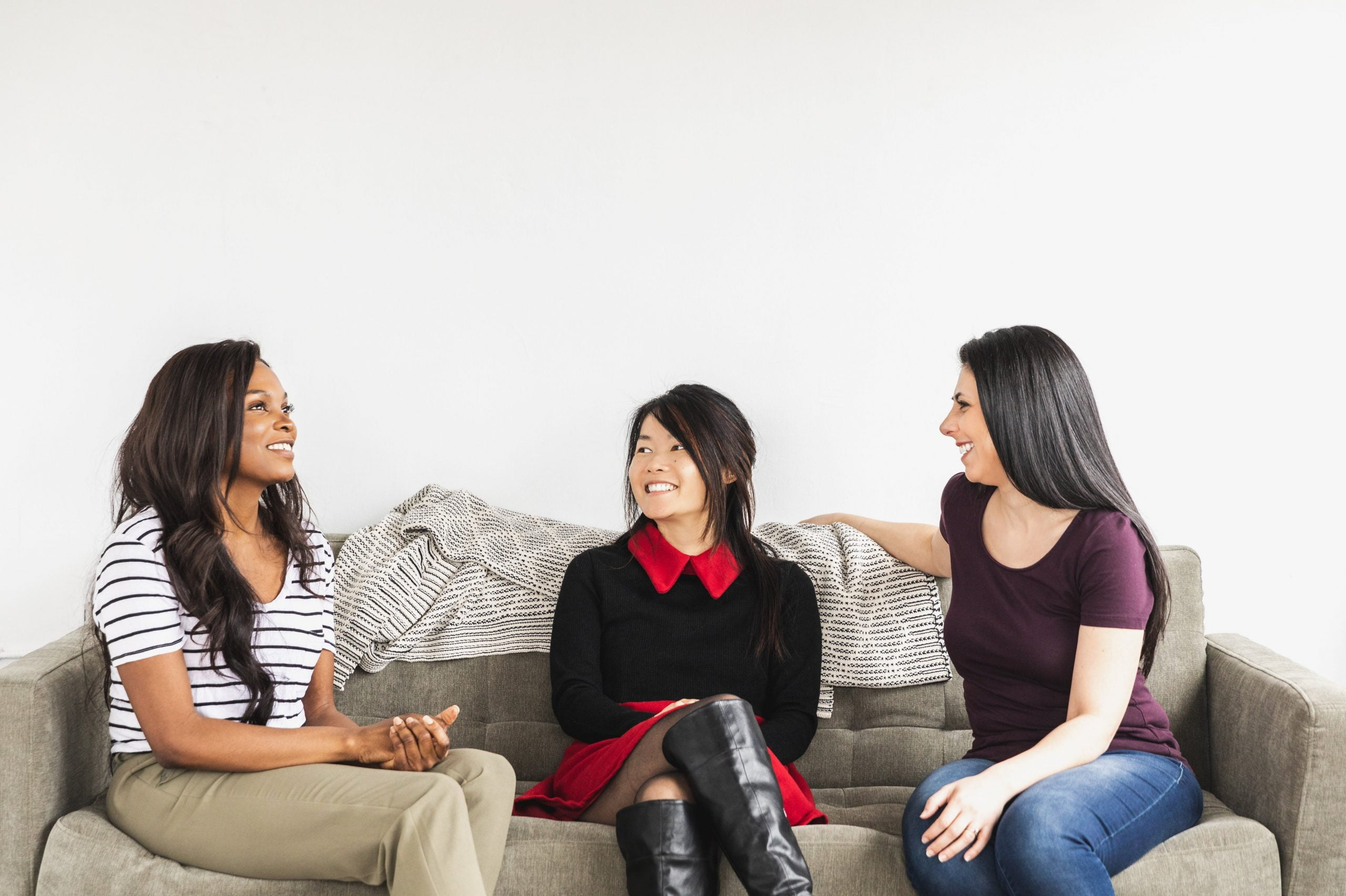 women chatting on a couch
